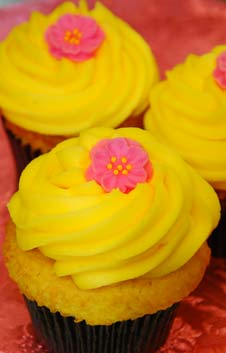 Yellow Cupcakes with Pink Flower